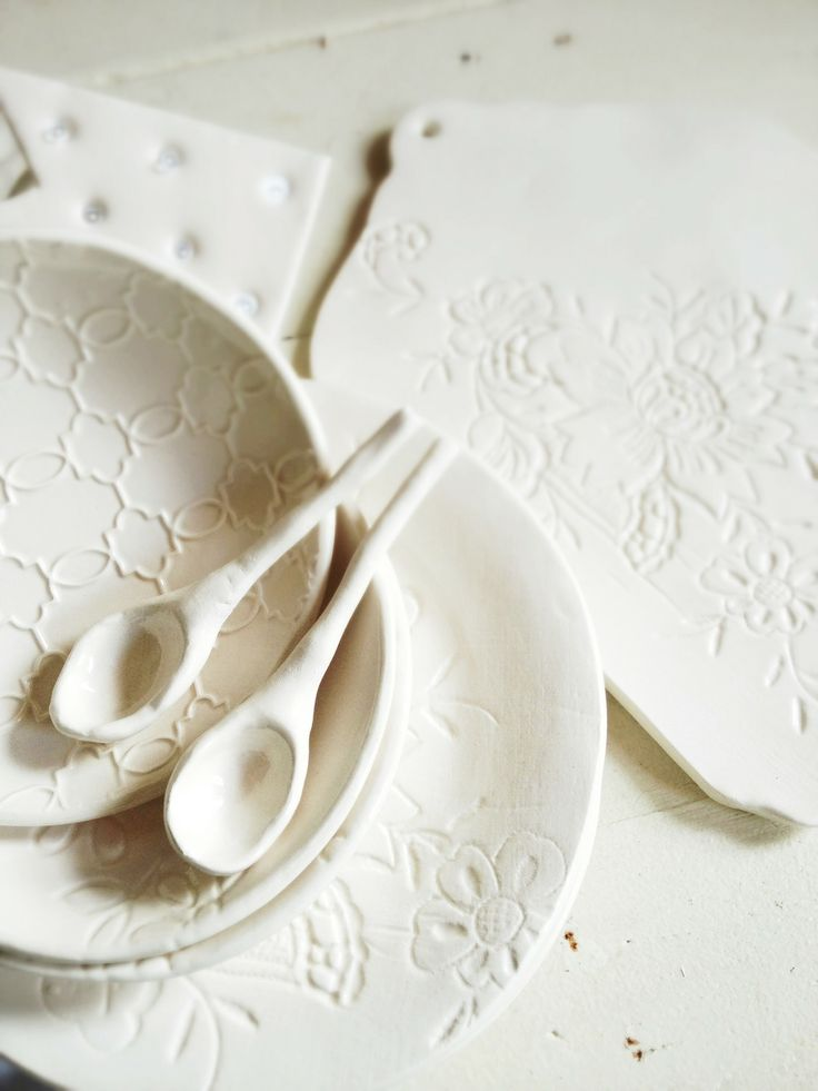 plates and spoons . cream tableware