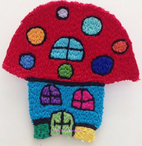 Magic Mushroom brooch.  2016.  Free machine embroidery using rayon and polyester threads.