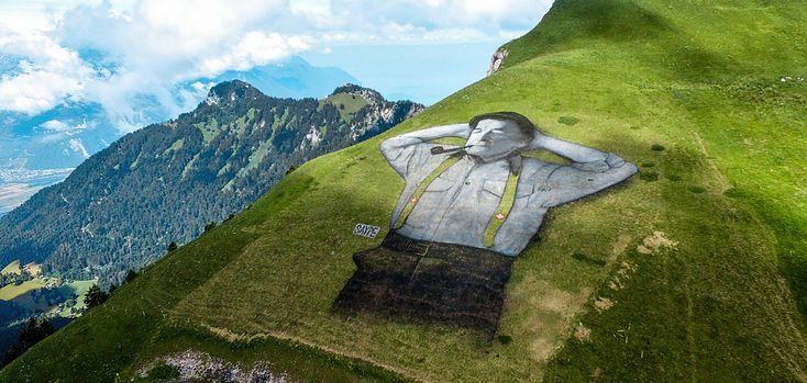 Нарисованный мужчина на склоне горы в Швейцарии