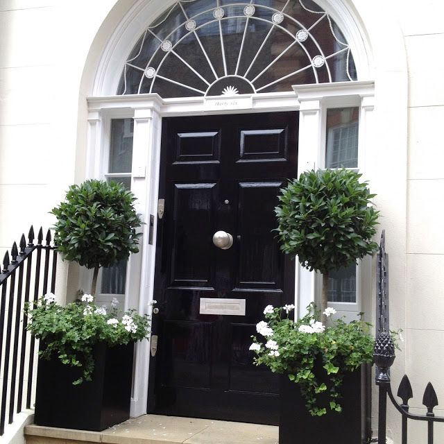 black front door in london - love the door furniture