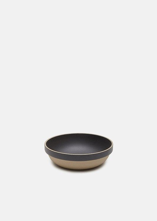 Black large round bowl in a blend of porcelain and clay, with a contrasting outer base for a colored effect. Textured finish throughout with a matte interior. S