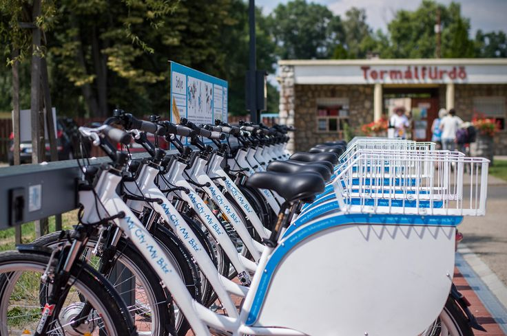 Electric Public Bike Rental System - Sellye station front of the Thermal bath