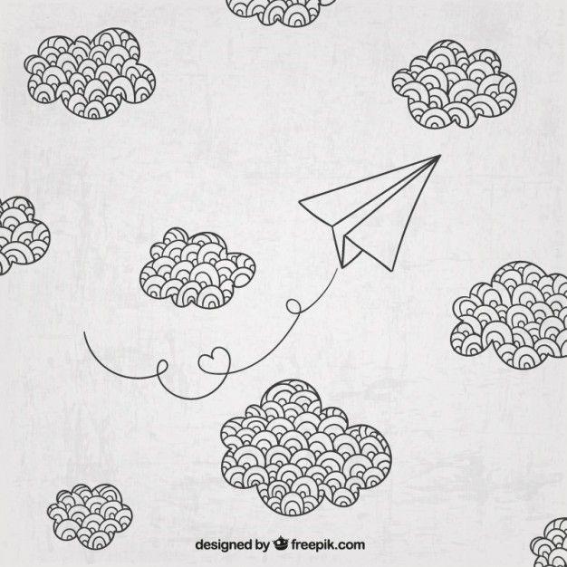 Mão avião de papel desenhado e nuvens Vetor grátis