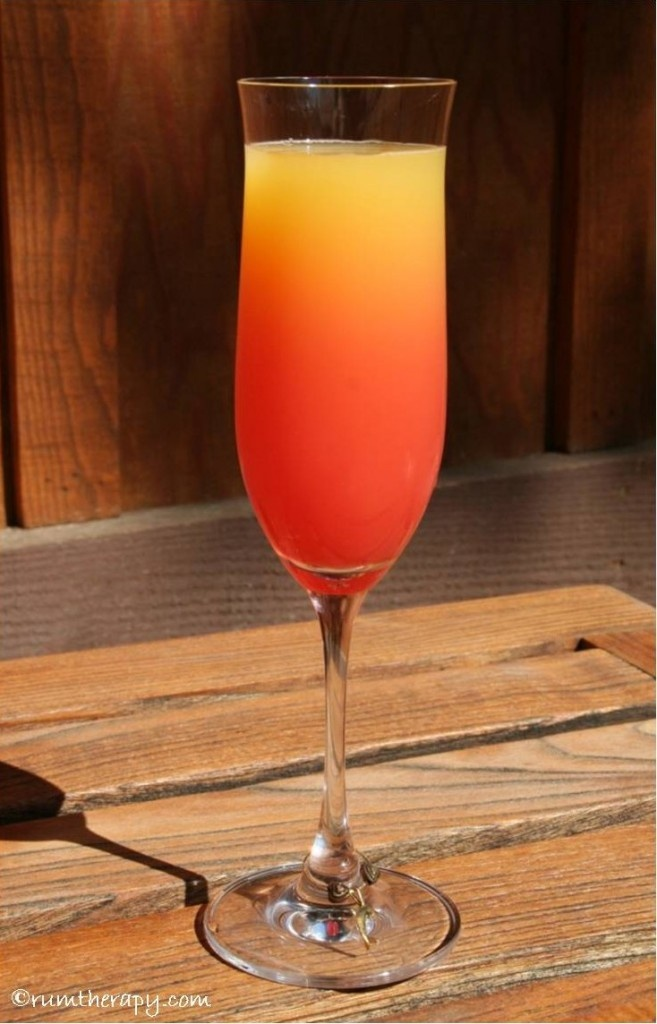 Shark Bite  (makes 1)  2 oz. 10 Cane Rum  3 oz. orange juice  1/2 oz. lime juice  1/2 oz. grenadine  Shake the rum, orange juice and lime with ice. Strain into a glass. Gently pour the grenadine on the top. Try not to think about sharks and enjoy!!