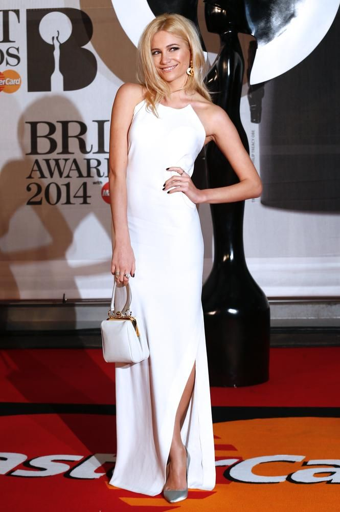 Pixie Lott let her dress do the talking and kept her hair and make up natural at the #Brits2014. We love the gold swinging earrings peaking out, but not sure about the silver shoe?  #PixieLott