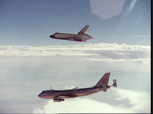 """August 12, 1977: Space Shuttle """"Enterprise"""" (OV-101) makes its first free flight from the back of a NASA 747 carrier aircraft for Shuttle Approach and Landing Tests (ALTs). Astronauts Fred W. Haise Jr., and C. Gordon Fullerton were the crew of the """"Enterprise."""" NASA Photo."""
