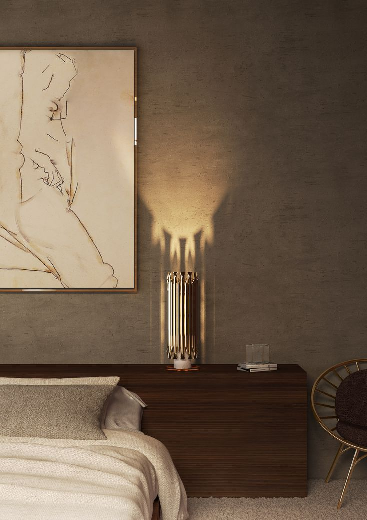 Ideal for a classic living room with a modern touch, Matheny stilnovo table lamp came to reinvent classic designs with a high aesthetic feeling. With a marble base and a shiny design, it will suit just perfectly your dining table or living room. Composed by geometric golden tubes, it reflects the sophistication of a timeless iconic piece.