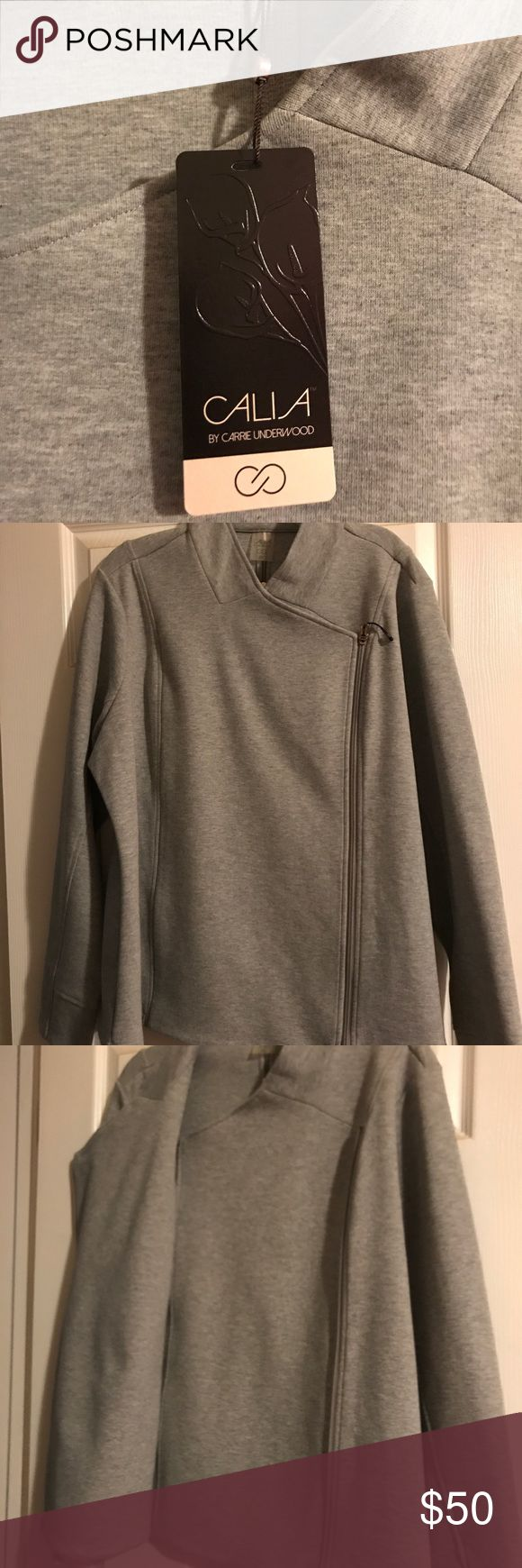 Calia by Carrie Underwood asymmetric zip jacket Brand new with tags and never been worn. Paid full retail at Dick's last winter. Lost weight and is too large. Smoke free home. CALIA by Carrie Underwood Jackets & Coats