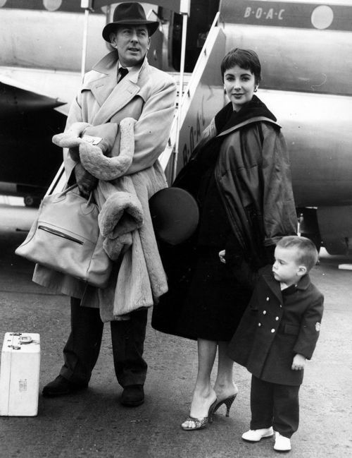Actress Elizabeth Taylor (1932-2011), with her husband, actor Michael Wilding (1912-1979), and her son