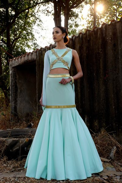 Light Lehenga - Fish Tail Lehenga with a Turquoise and Gold Crop Top with open Sleeve | WedMeGood Outfit by : Mahima Mahajan #wedmegood #indianwedding #indianbride #lehenga #turquoise