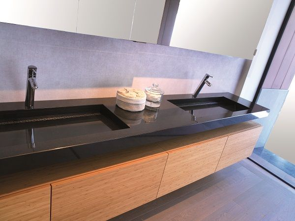 Assenti Pure with natural stone counter top. Exclusive design by Assenti. Base cabinet in Bamboe Steam.