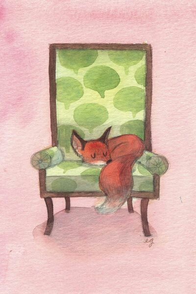 A red fox sleeping on a chair