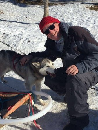 We love this picture of David playing with huskies in Alaska!