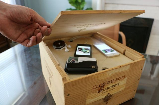 Tame your personal electronics with this wine crate storage system that's really a charging station.
