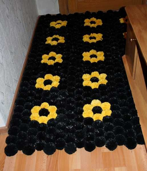 floor mat made of plastic bag pompons: