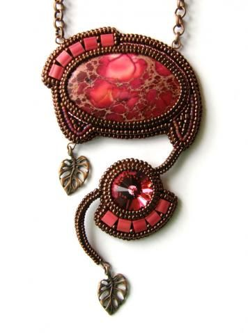 .Stunning! Absolutely wonderful bead and metal work.