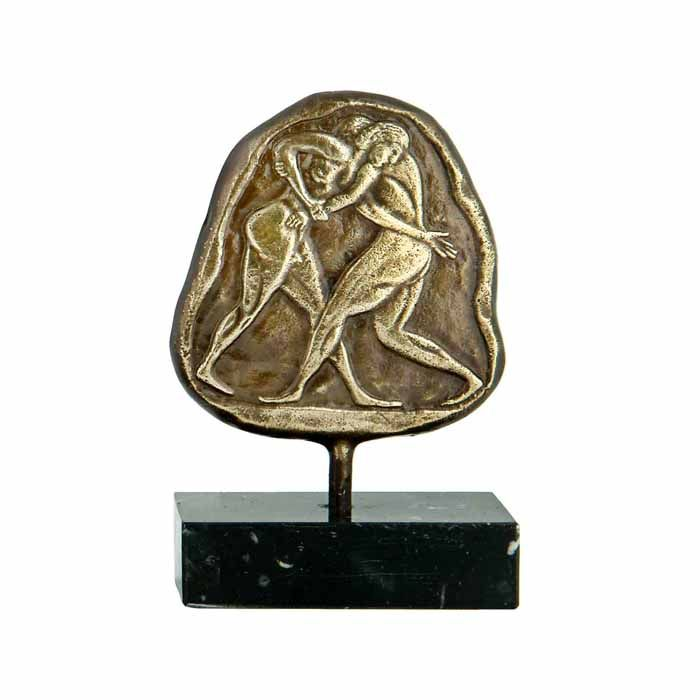 Relief plaque, depicting the Olympic feature of wrestling. Wrestling was one of the main events of the ancient Olympic Games, held in ancient Olympia.  Dimensions: 7cm x 10cm x 3,5cm Bronze with patina, placed on a greek black marble base, with white and grey waters.