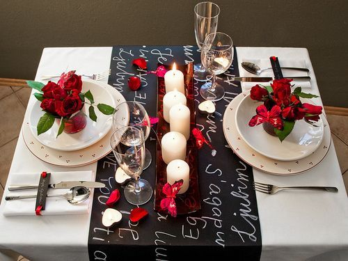 Romantic Valentine's Day Table Decorations With Candles Centerpiece And Black Table Cloth Also Beautiful Red Flower On White Dinner Plate For The Most Enchanting Valentine's Day Dinner Decorations For Lovers