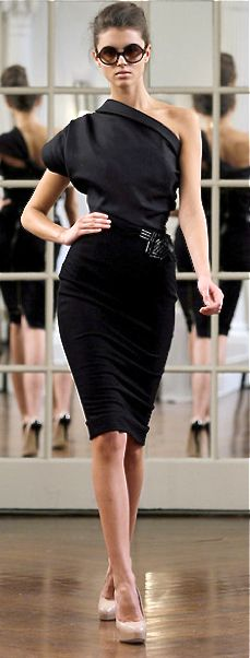I never that I would say this, but I love Victoria Beckham's designs.