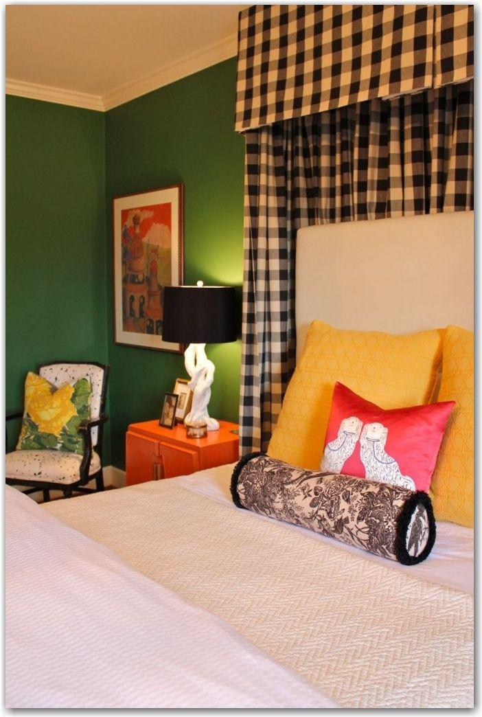 Green walls. Buffalo check. Colored nightstands.