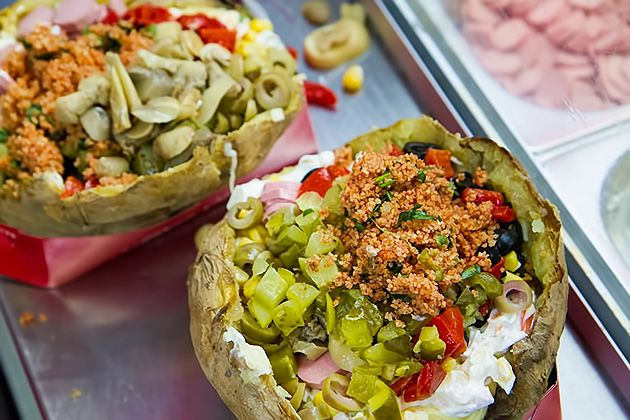 It's one of the best foods in Istanbul, the   Kumpir. You take a loaf of old and dry bread and you remove the crumb, then you can put whatever you want, what I prefer to put  more is some chicken, salad, tomatoes, tuna, capers, eggplant and cheese.