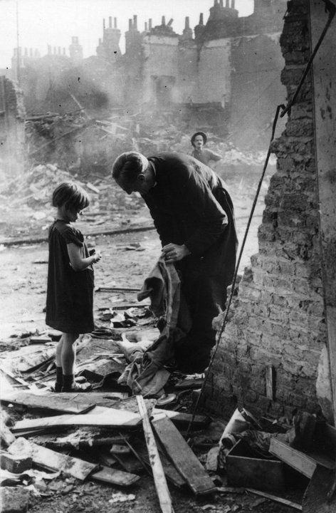 A priest talks to a young girl among debris left by the Blitz in Life of an East End Parson, 1940 (Bert Hardy/Getty Images)
