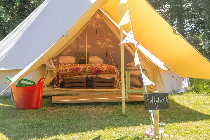 Glamping in Norfolk: Luxury bell tent and shepherd's hut glamping in the idyllic grounds of one of Norfolk's loveliest country house gardens.