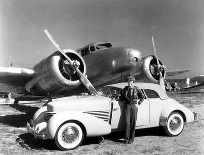Amelia Erhart with her Cord .The plane is her lockheed electra built to her specifications in 1936.