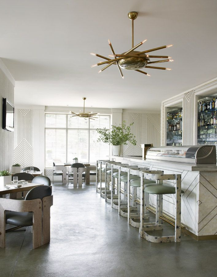 this kelly wearstler chandelier adds a pop to a minimalist space at nest lounge and caf