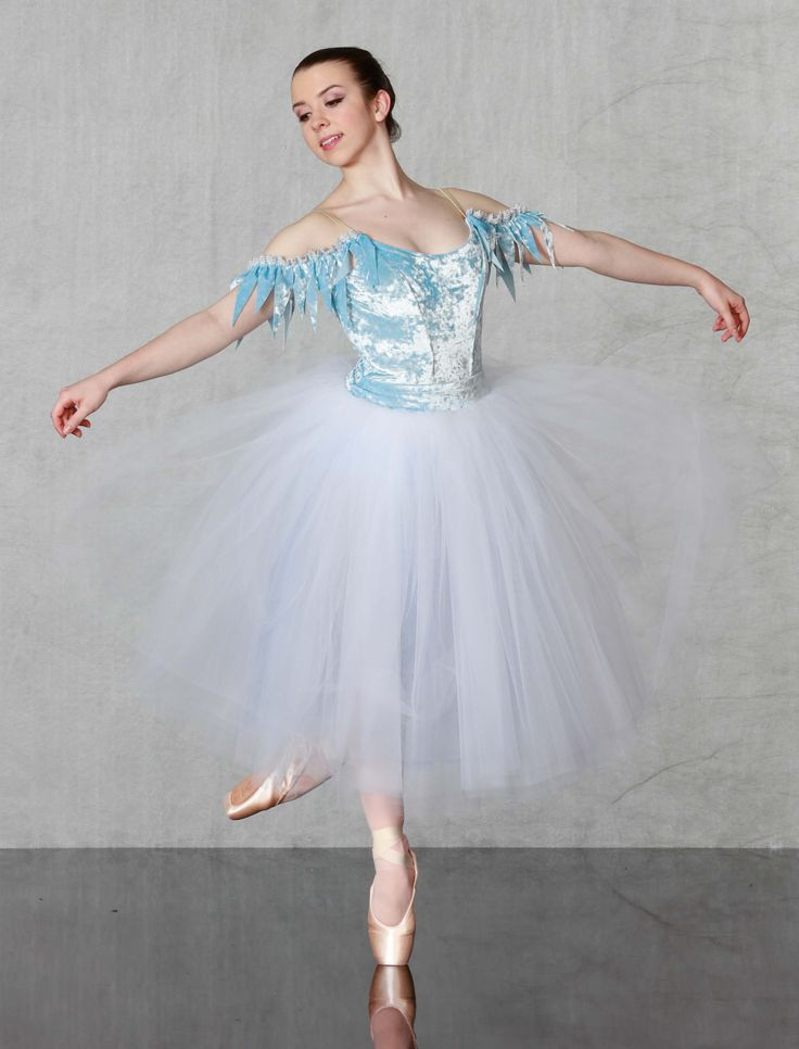 """SNOWFLAKES - Icicle dreams! Our """"Flexi Fit""""classical ballet bodice leotard and basque made in icey blue stretch velvet with generous 6 layer romantic 2 tone tulle tutu. Shoulder flounce trimmed in silver venice lace, rhinestone tiara included. Made just for you in all child and adult sizes!"""