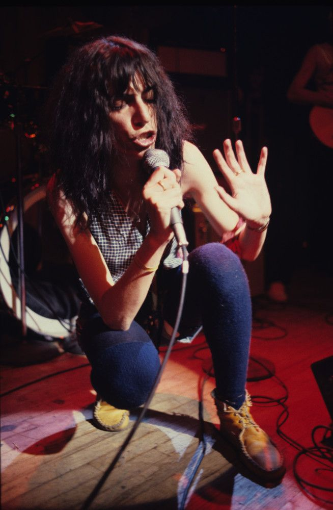 """Patti Smith onstage at the Second Chance Saloon in Ann Arbor, Michigan warming up for the release of the """"Easter"""" album and her signature breakout hit """"Because The Night""""<br /> <br /> Nothing like good old Kodachrome and a 35mm lens on a Nikon."""