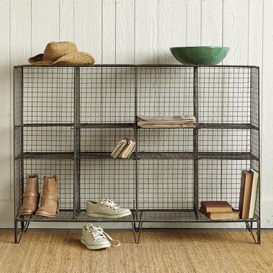 "STOREWELL LOW STORAGE SHELF -- Recently revamped, this free-standing storage unit is sturdier than ever before. Mix and match to suit your needs and let the vintage visage bring new world order to your home. Imported. Catalog exclusive. Assembly required. 48""W x 12""D x 34""H. Additional shipping, $20.  We have one in the warehouse for $300."