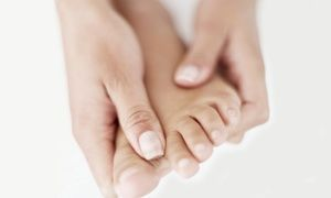 Doctor uses FDA-approved laser system to treat toenail fungus on a focused area