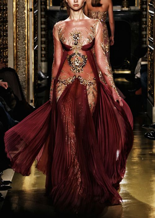 Costume inspiration -- Rich and opulent, covered but bare, fitted by flowing, sexy red dress