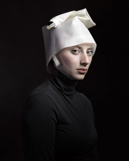 Hendrik Kerstens photographs daughter Paula- posing, lighting and styling her in the manner of famous Flemish art but uses everyday objects as the fashions.