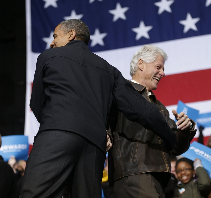 Love this! ~President Barack Obama and former President Bill Clinton, on stage at a campaign event in Bristow, VA on Saturday, Nov. 3, 2012. (AP Photo/Pablo Martinez Monsivais)