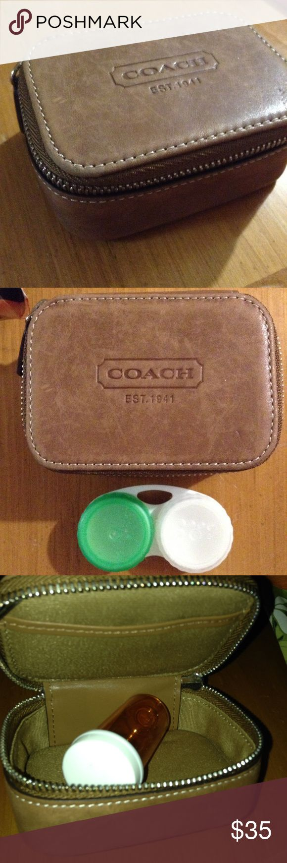 Coach Travel Pill/Jewelry Case Pre owned. Great condition, see pictures. Only comes with one pill bottle. 100% authentic. Can be used as jewelry, vitamin, pill, or contact lens box! Pet and smoke free home. Leather, brown. Make an offer? (: Thanks for checking out the listing! Contact lens case only in photo for size comparison! It does not come with the case, only the pill bottle comes with it! Coach Bags Travel Bags