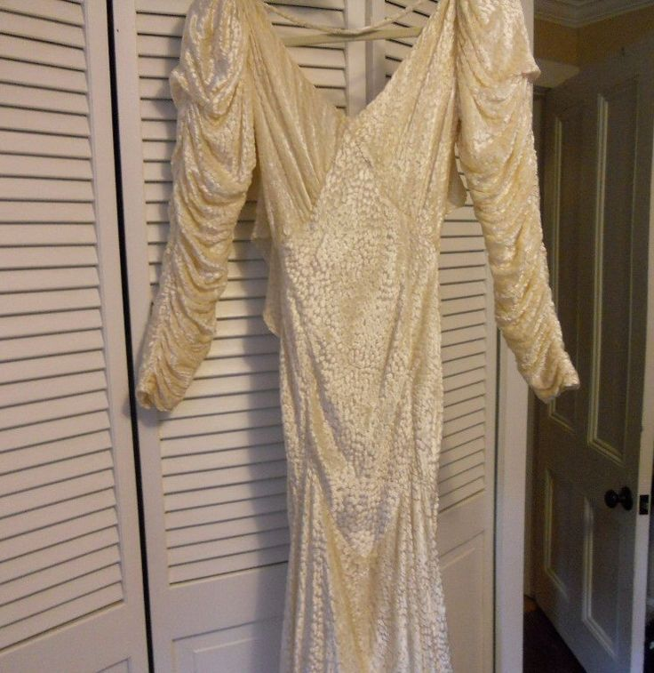 A personal favorite from my Etsy shop https://www.etsy.com/listing/231304532/vintage-david-fielden-wedding-gown