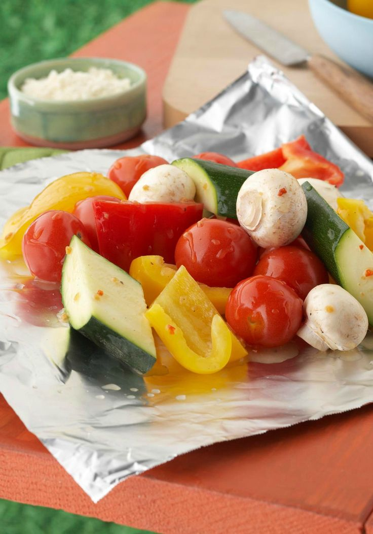 Sensational Foil-Pack Vegetables -- Scootch over burgers and make room for this flavorful, healthy living side dish recipe. Ripe veggies steam in their own juices and zesty dressing in a no-mess foil pack.