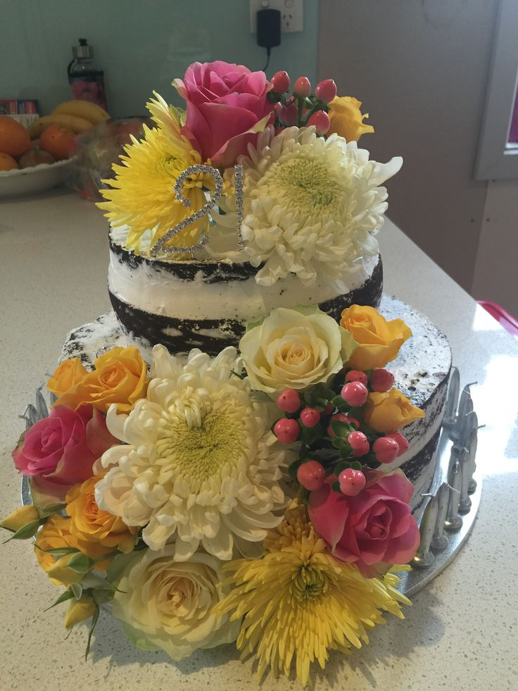 Naked cake. Fresh flowers