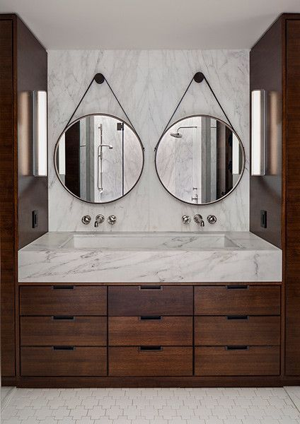 Double round mirrors and marble vanity.
