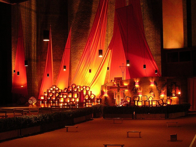 The Church of Reconciliation, Taize', France. Sections open to enable seating over 8000 young people. It even opens to the outdoors with a tent extension.