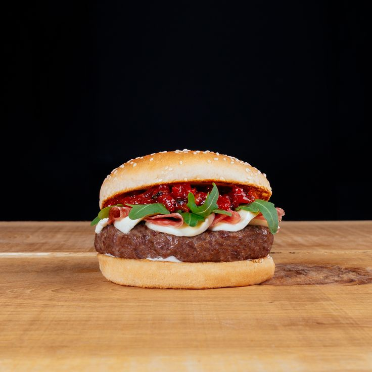 Special of the Month! Beef burger with mozzarella, Rocket salad, Italian salami, Hot tomato chutney & Basil mayo