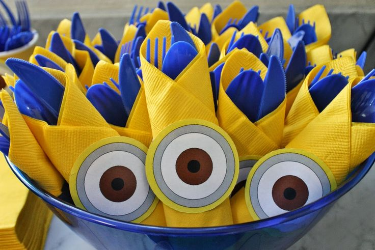 Minion cutlery party décor.  Click or visit fabeveryday.com for more photos and details from this Despicable Me Minions themed birthday party.