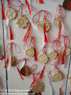 traditional martisor charms - sun symbols carved in wood by Moldavian artisan