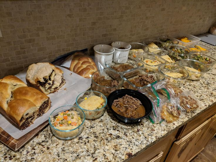 Chicken pot pie w/ biscuit topping pulled brisket and potato latkes broccoli walnut salad sausage frittata challah bread and chocolate babka.