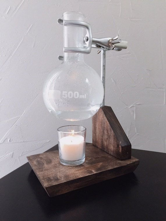Beautiful dark wood base holds antiqued chemistry beaker and clamps.  Works amazing, fills your home or office with natural scents.  Comes with 500ml
