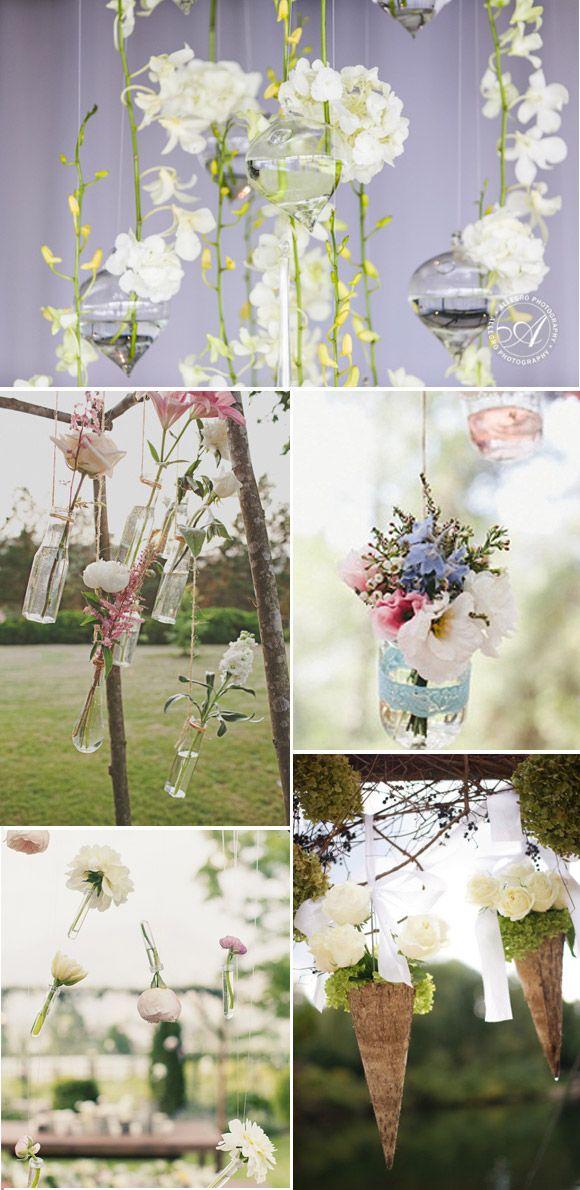 Decoración ceremonia de boda con flores colgantes