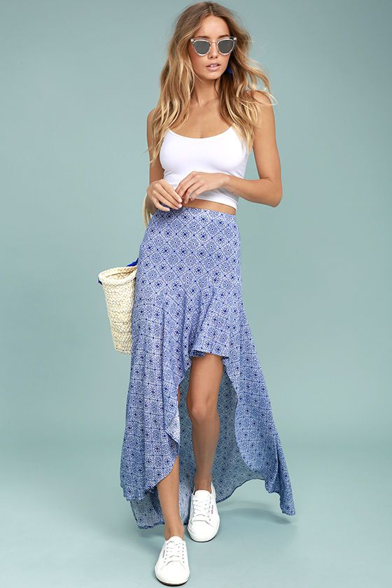 Show off your vacation style in the Mediterranean Beach Blue and White Print High-Low Maxi Skirt! Textured woven rayon has a blue and white print, beginning at a high, elasticized waistline, and continuing into a dramatic high-low maxi skirt. Hidden side zipper.