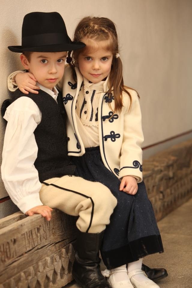 sweet hungarian children in folk and national embroidered dress